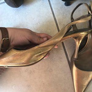 Gold strappy heels by Anne Klein